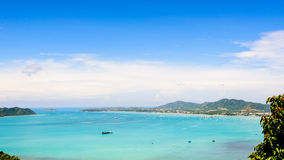 View blue sky over the Andaman Sea in Phuket, Thailand. High angle view blue sky over the Andaman Sea and seaside tourist town from Khao-Khad mountain viewpoint Royalty Free Stock Photo