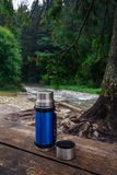 Coffe break on the hiking trail in the mountains. stock image