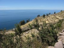 View of Lake Titicaca from Taquile Island, Peru. View of the blue water of Lake Titicaca at over 3800 m altitude from Taquile Island, Peru royalty free stock photography