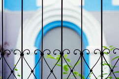 View of the blurred blue arch through the bars. In orthodox temple Stock Photo