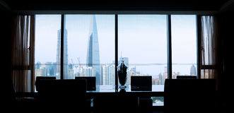 View of boardroom   and city buildings in backgr Stock Photos