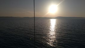 On the boat wben the evening is coming stock photography