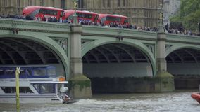 Boat and bus traffic near Parliament stock video footage