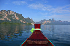 View from boat on Cheow Lan lake. View from moving long tail boat on Cheow Lan lake at Khao Sok National Park in Thailand Royalty Free Stock Photos