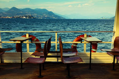 View from boat. View of empty seats on a boat traveling on the Lago Maggiore in north of Italy, overlooking the beautiful landscape with the lake and mountains Stock Photography