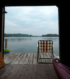 View from boat house and dock. View of lake in Gananoque from the boat house with chair and kayak on dock Stock Photography