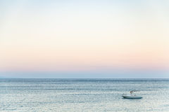 View of boat in Ionian sea in summer evening Stock Photos
