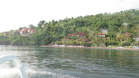 View from boat, lagoon and green coast village. Bali, Indonesi. A stock footage