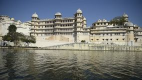 View from boat on lake and palace in Udaipur India. View from boat on lake and city palace in Udaipur India stock video footage