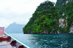View of the boat and the mountains in the river at Choew Lan Dam, Khao Sok National Park,. In Surat Thani, Southern Thailand Royalty Free Stock Photo