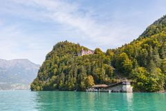 View from a boat over the turquoise lake Brienz to grand hotel g stock images