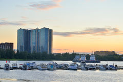 View of the boat pier on the outskirts of St. Petersburg at sunset. Royalty Free Stock Images