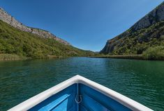 Boat sailing on the Cetina river Omis Croatia. View from the boat while sailing on the Cetina river in Omis. It is a town and port in the Dalmatia region. Its stock photos