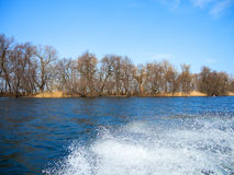 View from the boat. Through the spray on the shoreline of the river Stock Photos