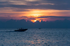 View of boat at sunrise Stock Images