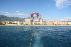 View from a boat to tied parachute with woman Royalty Free Stock Image