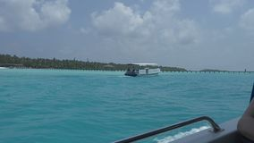 View from a boat on a tropical island with white sand and azure ocean. Maldives stock video
