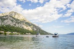 View on boats, beach and mountains behind in Gradac, Croatia. Popular destination. View on boats, beach and mountains behind in Gradac, Croatia. Popular tourist Royalty Free Stock Images