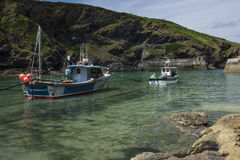 View of boats in Boscastle harbour. Cornwall, with broken anchor in foreground Stock Photo