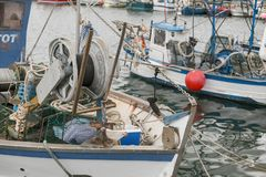 View of the boats with fishing gear in the port. View of the fishing boats in the port. Mooring of the small fishing vessel at the dock. Fishing gear and stock photos