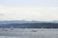 Boats sailing on Lake Zurich in Zurich, Switzerland. View of boats on the Lake Zurich in Zurich,  Switzerland Royalty Free Stock Photography