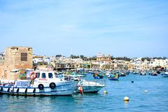 View of boats moored in Marsaxlokk harbour, Malta. Stock Images