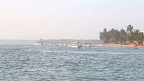 The view of boats in the ocean in Hikkaduwa while wind is blowing. stock video