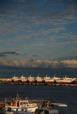 View of the boats on sea coast. Parked boats on pier in row royalty free stock photography