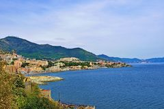 View of Boccadasse and the Ligurian sea, under a perfect blue sky, Genoa, Liguria, Italy 2019. royalty free stock images