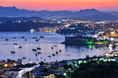 View of Bodrum harbor and Castle of St. Peter by night Stock Images