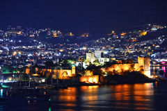 View of Bodrum harbor and Castle of St. Peter by night Royalty Free Stock Photos