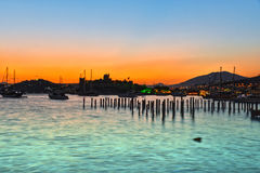 View of Bodrum harbor and Castle of St. Peter after sunset Royalty Free Stock Photos