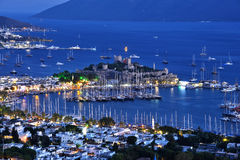 View of Bodrum harbor and Castle of St. Peter after sunset Stock Image