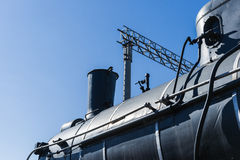 View of the boiler, chimney, and steam dome of an old steam loco Royalty Free Stock Photo