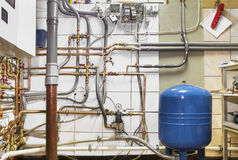 View of boiler room with copper and plastic pipes Royalty Free Stock Photography