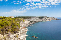 View of Bonifacio wild coast cliff rocks, Corsica island France Stock Images