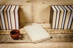 View of the book and a cup of tea on the shelf Stock Photography