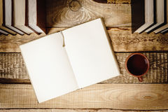 View of the book and a cup of tea on the shelf Royalty Free Stock Photography