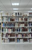 View of book shelves at a library. Close up of books pile at a local library Stock Photography