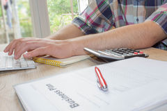 View of bookkeeper or financial inspector hands making report, calculating or checking balance. Business plan, calculator on the t stock photography