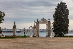 View of the Bosphorus through the fence grille in front of the Dolmabahce Palace in Istanbul, Turkey.  stock photos