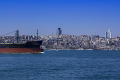 View of the Bosphorus and ships and barges sailing through it. View of Istanbul through the Bosphorus royalty free stock images