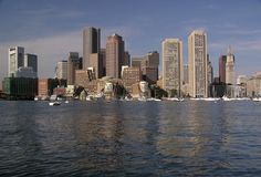 View of Boston from The Harbor 3. A morning view of the Boston skyline from a water taxi in Boston Harbor Royalty Free Stock Image