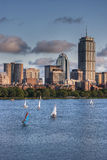 View of the Boston Skyline from the Charles River. Sailboats head toward the docks at sunset with a view of the Boston skyline in the background Royalty Free Stock Photography