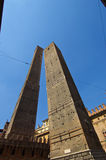 View from bottom of Asinelli and Garisenda Towers. Looking up at the Asinelli and Garisenda Towers in Bologna Italy, showing the way that the Garisenda Tower has Royalty Free Stock Photography