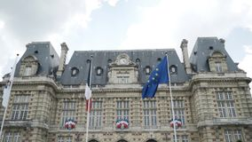 View from the bottom of awesome Paris Hotel-de-Ville building near the the flag of the European Union. Action. Paris. View from the bottom of awesome Paris Hotel stock video