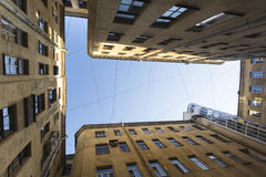 View from the bottom up in court yard-wells in the historic center of St. Petersburg, Russia. Travel. Royalty Free Stock Photos
