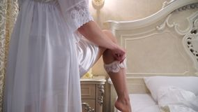 View from the bottom up on how she dresses bridal garter stock video footage
