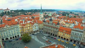 View from the bottom up on the the roofs of buildings and Church of St. Thomas in Prague from the top of St Nicholas stock footage