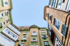 View from the bottom up at the sky, tall old houses, wells, balc Royalty Free Stock Image